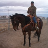 Ida, from the housing athority sitting on Doc(the horse)