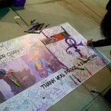 Banner to be hung on the fence at Paisley Park